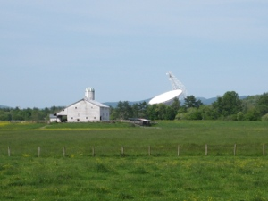 Green Bank Radio Telescope in background of farm